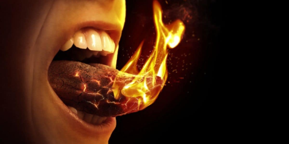 Why does my tongue feel like burning when my partner cum in my mouth?